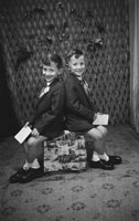 June 1962; Two boys pose for the camera at the studio in Tralee.
