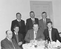 15th May 1964; Skipper Christy O'Shea, a 41 year old man from Valentia with guests, after he received a cheque for 750 Pounds from Bord Iascaigh Mhara as an incentive bonus for paying off a 9,000 Pound debt on his boat 'Ros Airgead', inside 10 years.