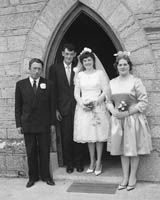 June 1964; A photo taken of a wedding couple and some of the Wedding Party on their Wedding Day in St Catherine's Church in Tralee.