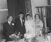 June 1964; A photo taken of a wedding couple and some of the Wedding Party on their Wedding Day at their reception at the Hotel Manhattan.