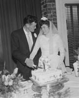 June 1964; A photo taken of a wedding couple on their Wedding Day at their reception at the Hotel Manhattan.