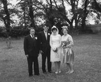 June 1964; A photo taken of a wedding couple and some of the Wedding Party on their Wedding Day.