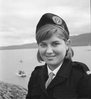 5th-12th  July 1964; A member of the Civil Defence smiles for the camera at Fenit Festival.