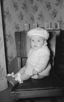 January 1964; A photo of a baby on his first birthday, taken at home.