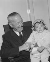 Dr Eamonn O'Sullivan with a Child