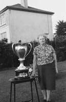 Mrs Bill Landers with the Jack Dempsey Trophy