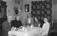 September 1964; His Excellency Most Reverend Archbishop McGuckan of San Francisco at the home of his cousin, James Tagney, Leebrook, Tralee. The Archbishop was on his way to Rome. He celebrated Holy Mass in the Presentation Convent in Castleisland, where his mother was from. In the photo L to R: James Tagney, Most Reverend Joseph T. McGuckan, Commandant Sean Hayes, Mrs Hayes, and Mrs Tagney.