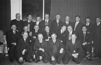 9th January 1964; A group of men pose for the camera at the Tarbert Milk Suppliers Dance in the Hotel Manhattan, Tralee. Tony O'Reilly is in the middle row, third from the right.