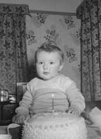 January 1964; A photo of a baby at home on his first birthday.