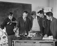 October 1964; Bobby Buckley (second from left), teaches the Senior Science Class at Causeway Technical School. Kerry's First Senior Technical Course provided Agricultural and Industrial students with an education in a natural environment. Subjects were: Rural Science, Construction, Engineering, Welding, Surveying, Land History, Biology and Calculations. Classes were on Mondays throughout October and November.