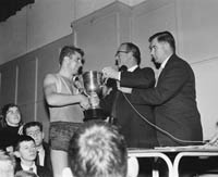 November 1964; FCA Basketball Team Captain Francis Fitzgibbon accepts the Trophy after his team beat the Dublin Garda Team in the final of the Brass Rail Basketball Blitz in the CYMS in Tralee.