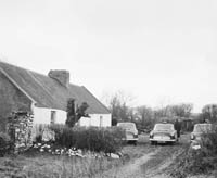 2nd March 1964; A photo of the house in Boola Firies of Edward Larkin who collapsed at his farmhouse and died in hospital the following day, aged 37 years. A post-mortem did not reveal the cause of death. In a preliminary investigation by Supt. John P. McMahon, a party of around 20 Gardai probed around the house, garden and fields at Boola.