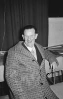 13th December 1964; A man smiles for the camera at the John Mitchels GAA Club Social in the Hotel Manhattan, Tralee.