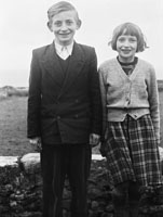 1955; Two School Children Posing For The Camera Outdoors In Kerry.