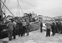 1953; Men Unloading Tractors From A Boat At Valentia Island Pier.