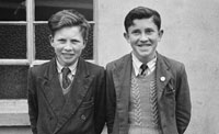 1955; Two Schoolboys Posing For The Camera At An Ceard Scoil In Listowel.