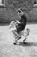 1955; A Schoolboy On A Toy Horse Posing For The Camera At A Kerry School.