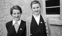 1955; Two Schoolgirls Posing For The Camera At A Kerry School.