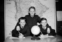 1955; Three Schoolboys Posing For The Camera Indoors At An Ceard Scoil In Listowel.
