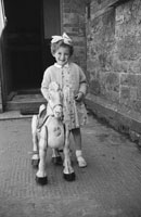 1955; A Schoolgirl Posing For The Camera With A Toy Horse At A Kerry School.