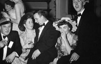 December 1955; Joe Treacy (centre) with a group at the Tralee Rugby Club Dance in Killarney.