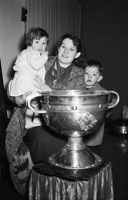 December 1955; A Studio Photo Of Mrs. Buckley And Her Family Of Kinsale With The Sam Maguire Cup.