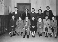 December 1955; A group posing for the camera at a Fáinne presentation in Tralee.
