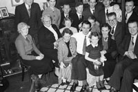 December 1955; Members of the Kennelly family posing for the camera with friends in Tralee. Arthur J O'Leary is at the centre of the back row.