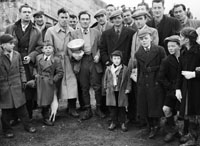 26th-28th December 1955; A Photo Of A Crowd Posing For The Camera With The Trophy At The Kingdom Cup Coursing Meeting At Tralee.