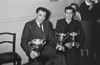 February 1954; Two Men With Their Trophies At The Kerins O'Rahillys Social At The Meadowlands Hotel, Tralee. The social was held to celebrate the clubs 1953 Senior County Championship win against Shannon Rangers. The final was held on the 20th September 1953 in Austin Stacks, where the Strand Road team defeated Shannon Rangers 1-4 to 0-5.