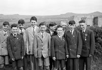 6th May 1957; A group of boys pose for the camera on their confirmation day in Ballyferriter.