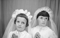 1953; A Studio Photo Of Two Communion Girls Posing For The Camera.