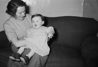 February 1954; A Woman With A Little Girl At Home