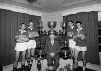 The Sheehy Family With Football Trophies