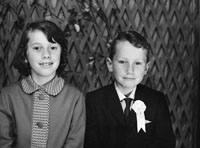 1953; A Studio Photo Of A Communion Boy And A Member Of His Family.