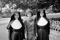 A Woman With Two Nuns