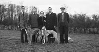 January 1954; Mr. O'Brien, Listellick, Tralee, With A Group And The Munster Cup Winning Greyhound Wild Iris.