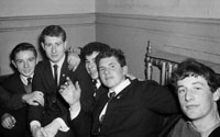 2nd February 1964; A group of young men  enjoying themselves at a dance in The Theatre Royal, Tralee.