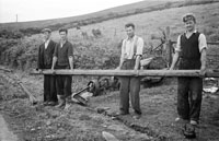 10th August 1956; A photo taken of a group of men at the site that was once the Dingle Railway Line.