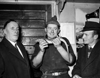 February 1964; A photo taken in the Dingle Fishermen's Co-operative. Tommy Devane is on the right of the photo.