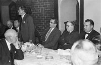 December 1955; A photo of Dr. Fitzgerald (foreground), W. Boyle (standing), Tom Ryle (3rd form right), and Hugh O'Donnell (far Right) at the Irish National Salmon Angling Association Dinner in Benner's Hotel Tralee.