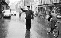 A Garda Conducting Traffic
