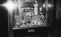 1955; A Photo Of A Shop Window Displaying Fish John West Products.