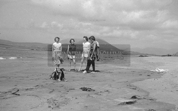 1953; Four Ladies Enjoying Themselves On The Beach With Their Dog On Valentia Island.