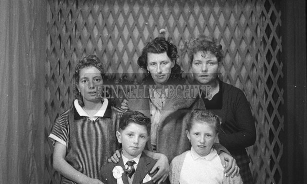 1953; A Studio Photo Of A Communion Boy And His Family.