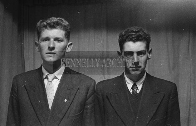 1953; A Studio Photo Of Two Men.