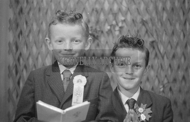 1953; A Studio Photo Of A Communion Boy And A Confirmation Boy Posing For The Camera.