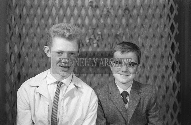 1953; A Studio Photo Of A Confirmation Boy with his brother.