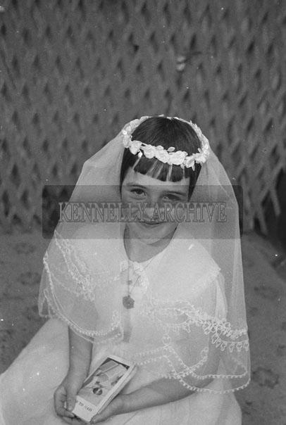 1953; A Studio Photo Of A Communion Girl.
