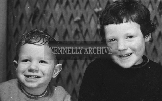 1953; A Studio Photo Of A Two Children From A Family.